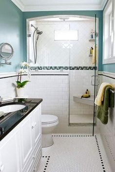 Avoid bouts of claustrophobia by giving a shower an airy appeal. Here, a wainscot tile job continues to the shower and stops short to squeeze in a glass shower door. The glass enclosure allows for more admiration for a band of mosaic tile work. Photo: J Bathroom Renos, Master Bathroom, Bathroom Ideas, Wainscoting Bathroom, Guest Bathrooms, 1920s Bathroom, Small Narrow Bathroom, Small Bathrooms, Shower Ideas