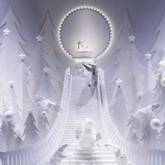 Galeries Lafayette, Paris Made to look almost like paper cut outs, the Galeries Lafayette windows focus on the fashion. Here, a brilliant staircase leads up to a Miu Miu shoe, complete with an illuminated platform. Christmas Windows, Christmas Window Display, Window Display Design, Noel Christmas, Window Displays, Interactive Display, Visual Display, Vitrine Design, Art Public