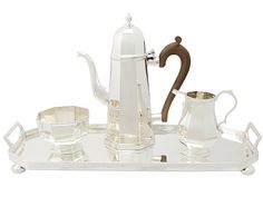 Sterling Silver Three Piece Coffee Service with Tray - George I Style - Vintage Elizabeth II  SKU: W8087 Price  GBP £1,695.00  http://www.acsilver.co.uk/shop/pc/Sterling-Silver-Three-Piece-Coffee-Service-with-Tray-George-I-Style-Vintage-Elizabeth-II-97p5922.htm#.VjnxBSs8rfc