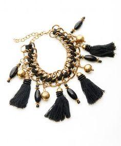 BUNGALOW 8 Black Tassel Bracelet $53 from http://www.shoplatitude.com/black-tassle-bracelet.html