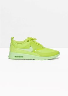 NIKE The Nike Air Max Thea features a sleek and low-cut design, offering both lasting comfort and understated style. The upper is textile-based with synthetic and leather overlays for targeted support and a lightweight feel.