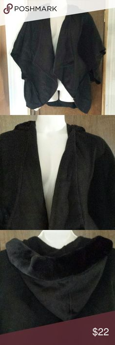 Calvin Klein hooded wrap in soft black One size poncho type wrap, handkerchief cut with reverse seams, kimono sleeves, and a hood trimmed with soft black faux fur. Medium weight fabric is very soft, kind of like felt. Never worn, brand new with tags. Calvin Klein Jackets & Coats