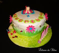 Little girl in the garden cake