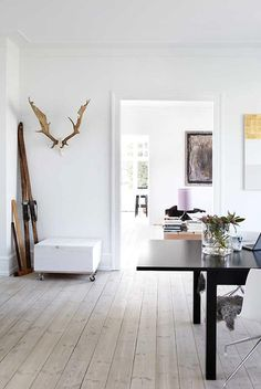 Danish apartment looks very bright and simple, where art does a job.