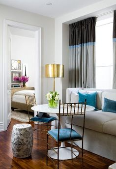 Toronto Interior Design Group: Chic living/dining space with multi-tone (black, blue & gray) silk curtains window ...
