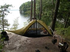hammock tent! This would solve the problem of your back hurting from sleeping on rocks :)
