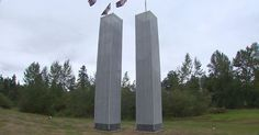 The replica World Trade Center twin towers stand more than 33 feet tall in an Edgewood yard.