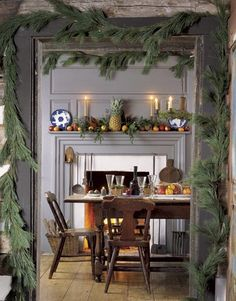 """Typical New England Decor. Greens, fruit, pineapple which means """"Welcome"""" and hospitality."""