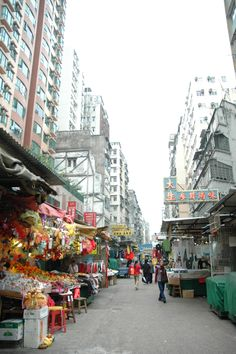 Mongkok, Kowloon. A popular district for shopping/food/entertainment. This is a typical vendor-aligned street.
