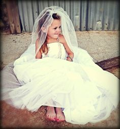Brinklee..my little girl in my wedding dress..I have always wanted to do this! Great photography idea for a little girl..