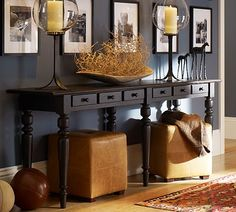 ottomans under console table