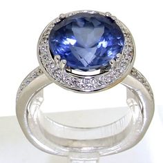 white gold rosette ring set with 26 brilliant cut diamonds with a total weight of ca. and a tanzanite with a total weight of ca. Vintage Silver Rings, Vintage Jewelry, Golden Ring, Tanzanite Ring, Silver Engagement Rings, Ring Designs, Heart Ring, White Gold, Photography Courses