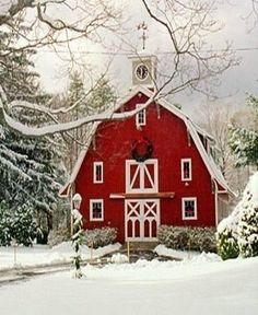 Red barn house with Christmas wreath, lamplight wrapped in evergreen garland, and a snowy landscape. What a refreshing country Christmas picture! Country Christmas, Winter Christmas, Christmas Time, Xmas, Christmas Ideas, Winter Snow, Merry Christmas, Cozy Winter, Christmas Mantles