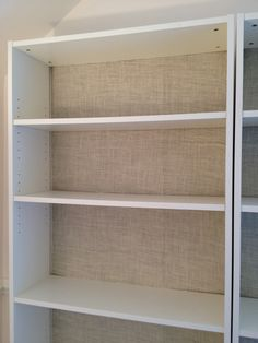 burlap backed ikea billy bookcases. can be backed in any color/fabric you like