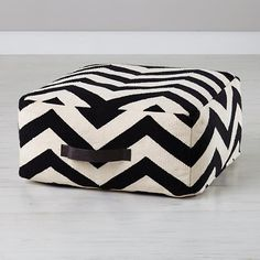 Chevron pouf features a bold, black and white pattern for a truly unique accent piece. it even has a handle, making it a breeze to move from room to room.