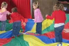 The smiles and laughter of the children as they delight in playing with a large, colorful parachute is testimony to how much fun parachute games are! Parachute play can be effectively combined with musical play for added enjoyment and learning. Preschool Music, Music Activities, Teaching Music, Activity Games, Teaching Kids, Preschool Ideas, Music Games, Playgroup Activities, Kindergarten Music