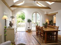 Arched entryway, wood flooring and skylights #homeimprovement #inspiration #ExteriorMedics