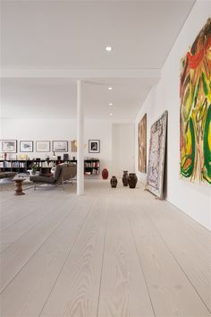 Large plank wooden floor, large art Living Area Modern Loft Design In Berline By Mikael Andersen Modern Wood Floors, Wooden Flooring, Plank Flooring, Hardwood Floors, Loft Design, House Design, Design Design, Design Ideas, Interior Minimalista