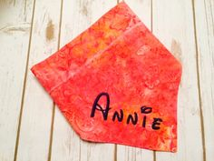 Peachy Pink and Orange Dog Bib or Bandana.  Peachy Batik is Monogrammed with your pet's name in purple.  Reversible to a multi-color design. by CollarRap on Etsy