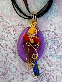 Handmade recycled Laurel Burch Purple PARROT on Howlite gemstone pendant and necklace by Texaswoman.  Recycled gold plated and enamel Laurel Burch piece. Wrapped with gold plated wire and the parrot is also gold plated. Measures 2 1/4 inches long and is about 1 1/8 inches wide. Comes on a 17 inch black organza ribbon necklace with a 2 inch chain extension. The bail is also large enough to wear the pendant on your own favorite necklace. https://www.etsy.com/shop/Texaswoman?ref=hdr_shop_menu