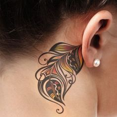 Woman with Behind-the-ear Colorful Feather Tattoo