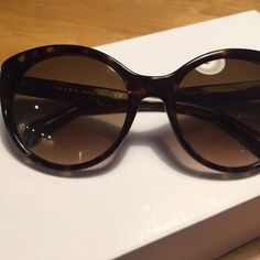 Prada cat eye sunglasses Bought from posher, 90% authentic and if not amazing quality. I would put my money on the authenticity, unfortunately I can't pull off a cat eye so my loss is your gain! Comes with missoni case and wipe. Worth the purchase! Prada Accessories Sunglasses