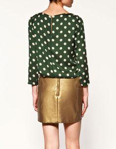 Back view: polka dot blouse from Zara.