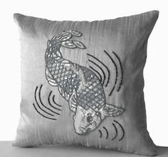 Grey faux silk pillow cover with a the legendary koi fish makes a classic accent especially in this muted color. One friendly carp swims across the middle of the pillow, revealing an elegant pattern r