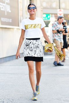 Giovanna Battaglia rocks a mini skirt with sneakers -- it's just the right amount of laid-back cool! #streetstyle
