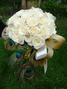 white bouquet with peacock feathers. Except the feathers would be sticking out and in the flowers  | followpics.co