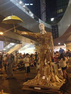 """""""The Umbrella Man statue, created by local artist Milk, sets the gold standard for major installation art.""""  -- Huffington Post"""
