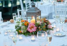 Rustic lanterns were surrounded by lush florals and greenery on the white-clothed reception tables. from the album: A Sweet Spring Wedding in Garrison, NY Mint Wedding Centerpieces, Lantern Centerpiece Wedding, Wedding Table, Centerpiece Ideas, Wedding Ideas, Wedding Mandap, Wedding Receptions, Free Wedding, Lantern Wedding