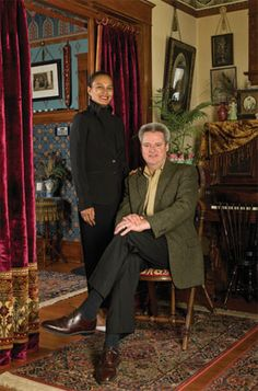 Homeowners Audry and Chris Bond (shown in the parlor) revived their Victorian home from years of neglect.