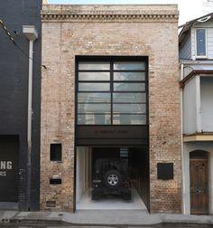 Rolling Door | Frosted Glass | Brick Building | Narrow House | Garage Door | Home Design | Curb Appeal