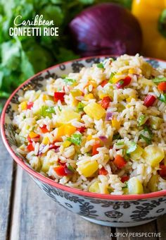 Caribbean Confetti Rice Recipe: A fragrant coconut rice recipe loaded with chiles sweet peppers pineapple cilantro and spices. Caribbean Confetti Rice Recipe: A fragrant coconut rice recipe loaded with chiles sweet peppers pineapple cilantro and spices. Caribbean Rice, Carribean Food, Caribbean Recipes, Rice Side Dishes, Vegetable Side Dishes, Confetti Rice Recipe, Rice Salad Recipes, Cilantro, Cooking Recipes