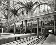 New York circa 1910. Pennsylvania Station, track level, showing stairway and elevators
