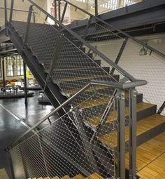 Stainless steel ferrule rope mesh is installed as indoor stair balustrade infill.