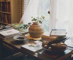 Julia Child at Home in Cambridge, Massachusetts  The grass-papered music room reveals the importance of books in the lives of Mr. and Mrs. Child.Photos | Architectural Digest