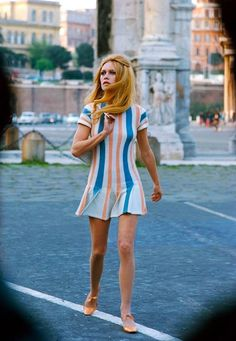 Brigitte Bardot during the filming of the movie 'Les Femmes' by Jean Aurel, in front of the Arch of Constantine, in the street in Rome, Italy, in 1969