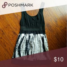 Simple black and white dress Very cute dress, black and white with tye dye design on skirt part. There is a thick elastic band giving the look of a small waist :) Xhilaration Dresses Mini