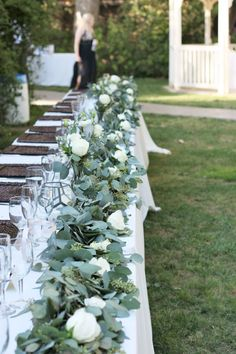 Take a look at the best wedding flowers for bridal table in the photos below and get ideas for your wedding flowers! Fleurie Flowers, Reedley, California – Head Table with a garland of foliages and white roses Image source Bridal Table Decorations, Head Table Decor, Decoration Table, Wedding Centerpieces, Wedding Bouquets, Round Table Centerpieces, Tall Centerpiece, Greenery Garland, Flower Garlands