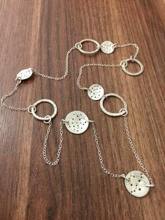 Long chain necklace with textured discs and chunky circles