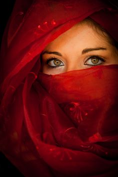 Once upon a time I was traveling threw Eastern India when I caught a fleeting glance from a mysterious lady in a red vale.  Her eyes were full of sadness and I wanted to know what had caused her to look so sad......