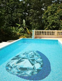Beautiful floral tile mosaic design on swimming pool floor by Rob ...