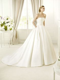 Its got freaking pockets!!!! Dramatic Princess Strapless Chapel Train Satin Wedding dRess with Beading