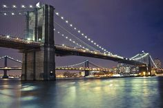 """The Brooklyn Bridge opened to the public on May 24, 1883, thereby connecting Manhattan with Brooklyn for the first time. Dubbed the """"Eighth Wonder of the World,"""" early visitors gawked at its immense granite towers and thick steel cables, not to mention its birds-eye views. The bridge, which took 14 years and around $15 million to complete, remains among New York City's top tourist attractions and a busy thoroughfare for commuters. http://histv.co/10UCfuc"""