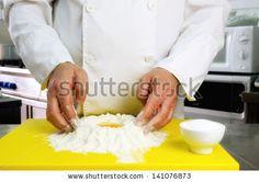 Chef hands detail, restaurant kitchen on background by MilaCroft, via ShutterStock