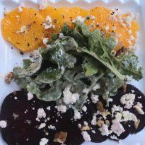 Beet, Feta and Orange #Salad: Seasoned beetroot and orange served with lettuce leaves, drenched in creamy yogurt dressing, crumbled feta, walnuts and herbs.