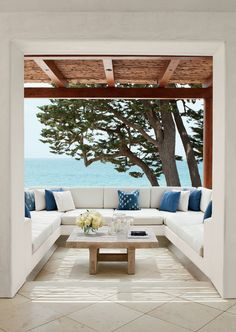 A classic Orange County vista—the Pacific through a gnarled Monterey cypress—is seen from the private study's terrace at a Southern California house