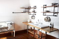 love these shelves made from pipe and boards